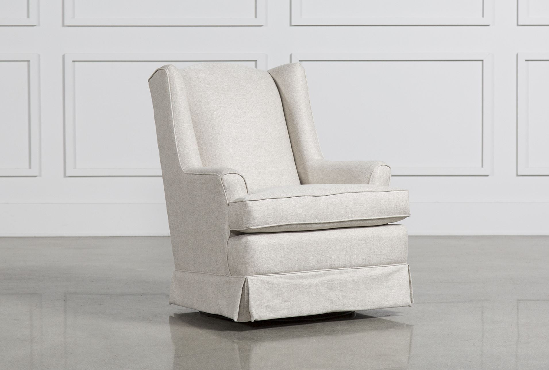 Bailey Flare Arm Wing Skirted Swivel Glider Living Spaces